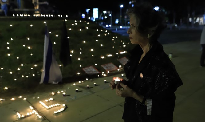 Candles in memory of the Meron disaster victims are lit in Tel Aviv