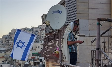 Jewish man prays outside his home in Shiloach
