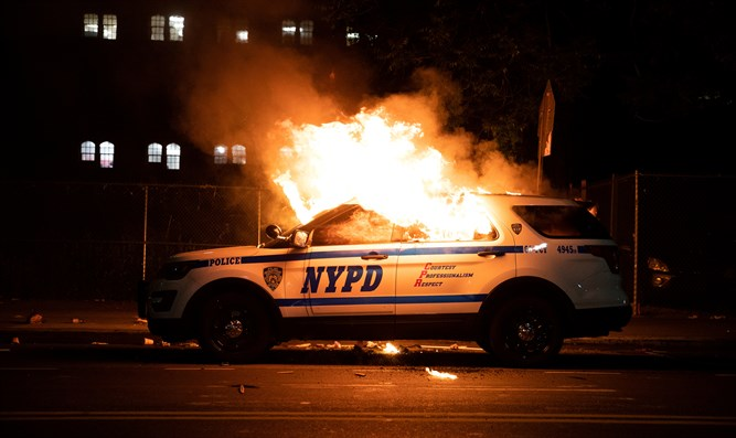 NYPD vehicle torched during riots in New York